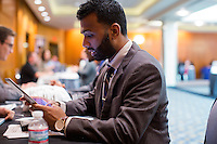 Ali Malik, an Army veteran from Queens, New York, fills out contact information for an Uber driver profile with Uber representatives who asked not to be named at the Recovering Warrior Employment Conference at the Back Bay Event Center in Boston, Massachusetts, USA. The employment conference was organized by Hiring Our Heroes and Wounded Warrior Project. Hiring Our Heroes is an initiative of the US Chamber of Commerce Foundation. Approximately 40 veterans registered for the event, during which they had interviews with a number of different regional and national employers, including GE, Bank of America, Uber, and others.