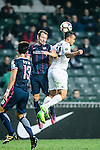 SC Kitchee Defender Helio de Souza (c) fights for the ball with Auckland City Midfielder Clayton Lewis (r) during the Nike Lunar New Year Cup 2017 match between SC Kitchee (HKG) and Auckland City FC (NZL) on January 31, 2017 in Hong Kong, Hong Kong. Photo by Marcio Rodrigo Machado / Power Sport Images