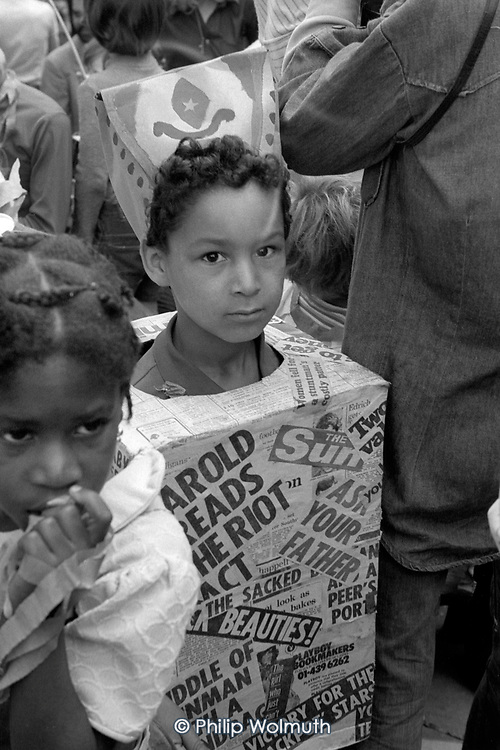 Children from Horniman's Adventure Playground, North Kensington, on a Notting Hill Carnival float, 1975.
