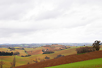 Malpere district west of Carcassonne. View over rolling hills and agricultural land in winter. Languedoc France Europe.