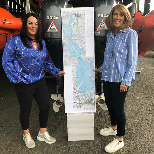 Karen Reynolds and Serena Friel with a lake chart of their swim route | Credit: RNLI/Tom McGuire