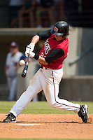 Carolina second baseman Kevin Randel makes contact versus Tennessee at Five County Stadium in Zebulon, NC, Sunday, July 2, 2006.  The Mudcats defeated the Smokies 4-0.