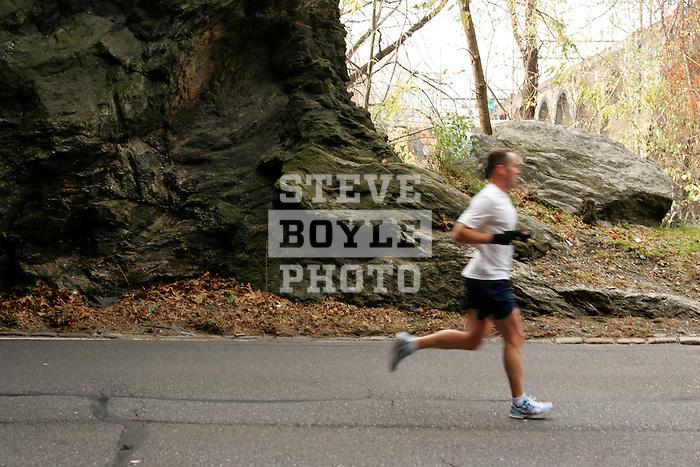 A runner emerges from a tunnel on Kelly Drive during the Philadelphia Marathon in Philadelphia, Pennsylvania on November 19, 2006.