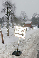 A sign indicates a polling location at James Mastricola Upper Elementary School at  Merrimack Ward 1 Primary Voting begins in Merrimack, New Hampshire, on Tue., Feb. 11, 2020.
