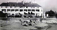 BNPS.co.uk (01202 558833)<br /> Pic: LewisShaw/BNPS<br /> <br /> Pictured: The Haven Hotel in the 1930s.<br /> <br /> Over 6,200 letters of objection have been lodged against controversial plans to replace a historic hotel with a 'soulless' block of flats at a millionaire's playground.<br /> <br /> The well-heeled residents of Sandbanks are up in arms about the £250million development which would see the Haven Hotel at the entrance to Poole Harbour in Dorset bulldozed.<br /> <br /> The 141-year-old building is where engineer Guglielmo Marconi established the world's first wireless communications. Under the plans, it would be replaced with a six-storey block of 119 luxury apartments.