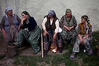 BULGARIA, Cherkovna, April 13, 2011. Bulgarian muslim women sit on a bench in the remote village of Cherkovna, north of Bulgaria. Bulgarian Muslims, which today are nearly 8% of the country's population and the largest muslim minority community in the European Union, revived their cultural and religious traditions after the fall of communist regime in Bulgaria in 1989. .BULGARIE, Cherkovna, 13 Avril 2011. Des femmes Bulgares de confession musulmane sont assisses sur un banc dans le petit village de Cherkovna au nord de la Bulgarie. La minorité musulmane qui représente aujourd'hui près de 8% de la population totale du pays et qui est la plus large majorité musulmane dans les pays de l'Union Européenne a ravive ses traditions culturelles et religieuse après la chute du régime communiste Bulgare en 1989.