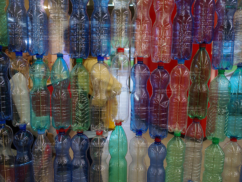"""Switzerland. Canton Ticino. Colorful PET plastic bottles at entrance of """"ti-riciclo"""", the first fair (may 8-10, 2015) dealing about waste and recycling issues in the italian part of Switzerland. 8.05.2015 © 2015 Didier Ruef"""