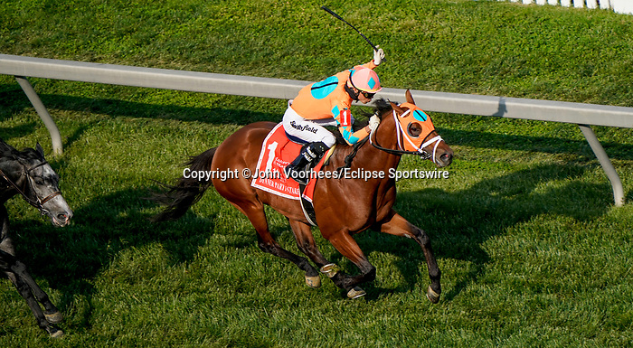 May 15, 2021: Somelikeitbrown, #1, ridden by jockey Jose Ortiz, wins the Dinner Party Stakes on Preakness Stakes Day at Pimlico Race Course in Baltimore, Maryland. John Voorhees/Eclipse Sportswire/CSM