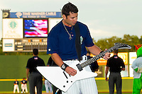 Charlotte Knights catcher Adam Ricks #16 plays the National Anthem on his guitar prior to the International League game against the Pawtucket Red Sox at Knights Stadium on August 11, 2011 in Fort Mill, South Carolina.  The Red Sox defeated the Knights 3-2.   (Brian Westerholt / Four Seam Images)