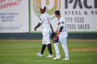 Great Falls Voyagers right fielder Luis Mieses (5) laughs with second baseman Kelvin Maldonado (1) during a Pioneer League game against the Missoula Osprey at Centene Stadium at Legion Park on August 19, 2019 in Great Falls, Montana. Missoula defeated Great Falls 1-0 in the second game of a doubleheader. (Zachary Lucy/Four Seam Images)