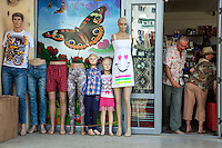 Romania. Iași County. Iasi. Town center. Shop window with butterfly. Manikins with clothes for sale. Iași (also referred to as Iasi, Jassy or Iassy) is the largest city in eastern Romania and the seat of Iași County. Located in the Moldavia region, Iași has traditionally been one of the leading centres of Romanian social life. The city was the capital of the Principality of Moldavia from 1564 to 1859, then of the United Principalities from 1859 to 1862, and the capital of Romania from 1916 to 1918. 15.06.15 © 2015 Didier Ruef