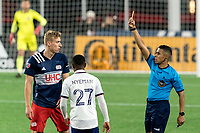FOXBOROUGH, MA - APRIL 24: Guido Gonzales Jr issues yellow card to Adam Buksa #9 of New England Revolution during a game between D.C. United and New England Revolution at Gillette Stadium on April 24, 2021 in Foxborough, Massachusetts.