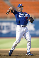 Tyler Houston of the Los Angeles Dodgers throws before a 2002 MLB season game at Dodger Stadium, in Los Angeles, California. (Larry Goren/Four Seam Images)
