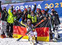 13th February 2021, Cortina, Italy; FIS World Championship Womens Downhill Skiing;   Silver medal winner Kira Weidle of Germany with her Team during the winners ceremony