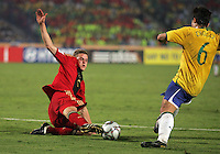 Germany's Sven Bender (6) puts an end to a goal drive by Brazil's Diogo (6) during the FIFA Under 20 World Cup Quarter-final match at the Cairo International Stadium in Cairo, Egypt, on October 10, 2009. Germany lost 2-1 in overtime play.