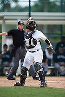 GCL Pirates catcher Yoel Gonzalez (5) throws to first during the first game of a doubleheader against the GCL Yankees 2 on July 31, 2015 at the Pirate City in Bradenton, Florida.  GCL Pirates defeated the GCL Yankees 2 2-1.  (Mike Janes/Four Seam Images)