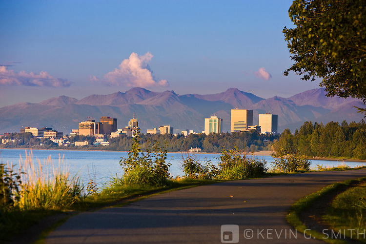 The Anchorage Skyline at sunset, and Tony Knowles Coastal Trail, late summer, Anchorage, Southcentral Alaska, USA.
