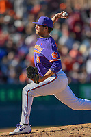 Starting pitcher Brooks Crawford (19) of the Clemson Tigers delivers a pitch in the Reedy River Rivalry game against the South Carolina Gamecocks on Saturday, March 3, 2018, at Fluor Field at the West End in Greenville, South Carolina. Clemson won, 5-1. (Tom Priddy/Four Seam Images)