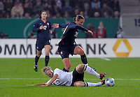 Kim Kulig tackles Abby Wambach. US Women's National Team defeated Germany 1-0 at Impuls Arena in Augsburg, Germany on October 29, 2009.