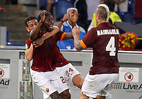 Calcio, Serie A: Roma vs Fiorentina. Roma, stadio Olimpico, 30 agosto 2014.<br /> Roma forward Gervinho, of Ivory Coast, center, celebrates with teammates Alessandro Florenzi, left, and Radja Nainggolan, of Belgium, after scoring in the last seconds of the Italian Serie A football match between AS Roma and Fiorentina at Rome's Olympic stadium, 30 August 2014. AS Roma won 2-0.<br /> UPDATE IMAGES PRESS/Riccardo De Luca