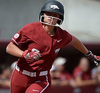 Arkansas outfielder K.B Sides scores Saturday, Oct. 9, 2021, during play against Butler Community College at Bogle Park in Fayetteville. Visit nwaonline.com/211010Daily/ for today's photo gallery.<br /> (NWA Democrat-Gazette/Andy Shupe)