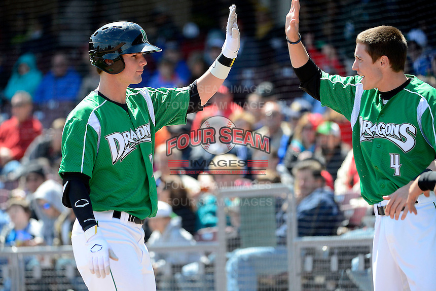 Dayton Dragons outfielder Jesse Winker #23 greeted by Zach Vincej #4 after hitting a home run during a game against the Bowling Green Hot Rods on April 21, 2013 at Fifth Third Field in Dayton, Ohio.  Bowling Green defeated Dayton 7-5.  (Mike Janes/Four Seam Images)