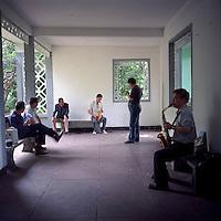 Amateur musicians play saxophone at Zhongshan Park in Shanghai, 2011. (Mamiya 6, 75mm f3.5, Kodak Ektar 100 film)