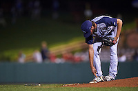 Brooklyn Cyclones pitcher Craig Missigman (26) removes dirt from his cleats during a game against the Tri-City ValleyCats on September 1, 2015 at Joseph L. Bruno Stadium in Troy, New York.  Tri-City defeated Brooklyn 5-4.  (Mike Janes/Four Seam Images)