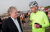 Quebec Premier Jean Charest and businessmen Louis Garneau talk before the Ride in Silence event in Quebec City May 19, 2010. Ride in Silence is a worldwide event being held tonight to honor those injured or killed while cycling on public roads.<br /> <br /> PHOTO :  Francis Vachon - Agence Quebec Presse