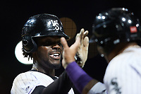Jeremiah Burks (4) of the Winston-Salem Dash celebrates with a teammate after hitting a home run against the Bowling Green Hot Rods at Truist Stadium on September 9, 2021 in Winston-Salem, North Carolina. (Brian Westerholt/Four Seam Images)