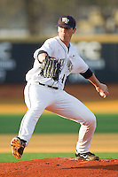 Starting pitcher Brian Holmes #45 of the Wake Forest Demon Deacons in action against the Charlotte 49ers at Gene Hooks Field on March 22, 2011 in Winston-Salem, North Carolina.   Photo by Brian Westerholt / Four Seam Images