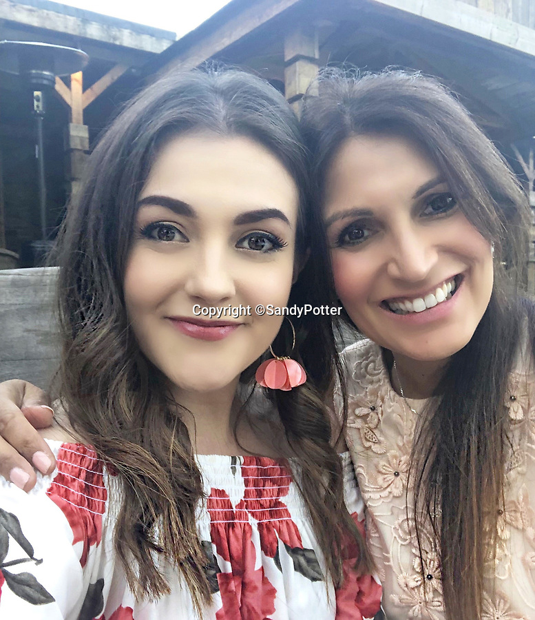 BNPS.co.uk (01202 558833)<br /> Pic: SandyPotter/BNPS<br /> <br /> PICTURED: Sandy Potter with her daughter Sophie<br /> <br /> A mother who became a property developer to support her daughters after a divorce has unveiled her latest stunning holiday let - a stunning converted 15th century water mill.<br /> <br /> Sandy Potter, 53, has transformed The Water Mill, in Derbys, into a 16 person detached holiday home nestled in the heart of the idyllic Peak District countryside.<br /> <br /> The Grade II listed property features in the Domesday Records and was used to mill corn and wheat until about 1960.<br /> <br /> She has restored its 300 year old water wheel, and the seven bedroom holiday home retains its ancient stonework and oak beams.<br /> <br /> More modern touches include a luxurious Champagne bar and a hot tub.