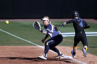 DURHAM, NC - FEBRUARY 29: Quinn Biggio #4 of University of Notre Dame puts out Kendyl Lange #4 of Duke University at first base during a game between Notre Dame and Duke at Duke Softball Stadium on February 29, 2020 in Durham, North Carolina.
