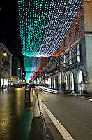 Rome, Via del Corso, one of the Capital's main shopping streets with the christmas decorations rememebering the 150th anniversay of the Italian Union