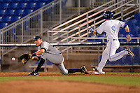 Tampa Yankees first baseman Matt Snyder #29 takes a throw as Andy Burns #9 beats it out during a game against the Dunedin Blue Jays on April 11, 2013 at Florida Auto Exchange Stadium in Dunedin, Florida.  Dunedin defeated Tampa 3-2 in 11 innings.  (Mike Janes/Four Seam Images)