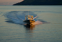 A high speed dive boat in the Truk lagoon return with divers, Chuuk Micronesia