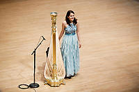 Harpist Lenka Petrovic stands to take a bow during her laureate recital at the 11th USA International Harp Competition at Indiana University in Bloomington, Indiana on Sunday, July 7, 2019. (Photo by James Brosher)