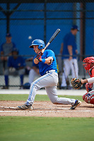 Toronto Blue Jays third baseman Davis Schneider (17) follows through on a swing during an Instructional League game against the Philadelphia Phillies on October 7, 2017 at the Englebert Complex in Dunedin, Florida.  (Mike Janes/Four Seam Images)