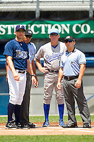 Princeton Rays manager Mike Johns #9 goes over the ground rules with Burlington Royals manager Tommy Shields #19 and umpires Jeremie Rehak (left) and Jordan Albarado at Hunnicutt Field on July 15, 2012 in Princeton, West Virginia.  The Royals defeated the Rays 2-0 in game one of a double header.  (Brian Westerholt/Four Seam Images)