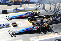 Oct. 14, 2011; Chandler, AZ, USA; NHRA top fuel dragster driver Cory McClenathan (near lane) races alongside Mike Strasburg during qualifying at the Arizona Nationals at Firebird International Raceway. Mandatory Credit: Mark J. Rebilas-