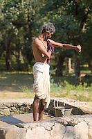 Man taking bath in jungle of Ranthambore National Park, Rajastan, India