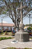 Antigua, Guatemala. Cross in the square facing the Escuela de Cristo Church.