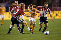 Houston Dynamo's Dwayne De Rosario attempts to move past Chivas defender Jim Curtin (l) and Jesse Marsch (r). The Houston Dynamo and Chivas USA played to a 1-1 tie at Home Depot Center stadium in Carson, California on Saturday October 25, 2008. Photo by Michael Janosz/isiphotos.com
