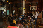 People sit outside a coffee shop as cafes, restaurants and other eateries reopened in some provinces across the country, in Istanbul, Turkey, on March 5, 2021. The businesses are allowed to operate at half-capacity between the hours of 7:00 a.m. and 07:00 p.m. as coronavirus restrictions are eased. Photo by Shady Al-Assar