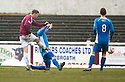 Arbroath's Euan Smith scores the opener.