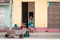 27/07/18<br /> <br /> Street trader and woman wearing USA Stars and Stripes leggings, Trinidad, Cuba.<br /> <br /> All Rights Reserved, F Stop Press Ltd. (0)1335 344240 +44 (0)7765 242650  www.fstoppress.com rod@fstoppress.com