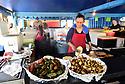 Delicia Jendi serves El Salvadoran food at the Algiers Flea Market. Jendi Bonilla cooks at her restaurant.