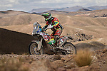 """Motorcycle rider Juan Carlos """"Chavo"""" Salvatierra from Bolivia riding his KTM bike during the 5th stage of the Dakar Rally 2016 in the Bolivian Altiplano."""