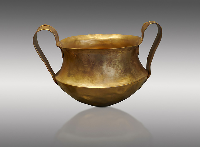 Two handled Mycenaean gold bowl cup from the Kakovatos tholos tomb, Trifylia, Greece. National Archaeological Museum Athens.  Grey Background<br /> <br /> Kakovatos is a significant site of the early Mycenaean period of Greece (c. 16th to 15th century BC) on the west coast of the Peloponnese (Zacharo, Nomos Elis) and became widely known through the excavations of three large tholos tombs by Wilhelm Dörpfeld in 1907–1908.