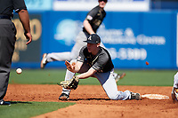 Army West Point Tim Simoes (8) fields a throw on a stolen base during a game against the Michigan Wolverines on February 18, 2018 at First Data Field in St. Lucie, Florida.  Michigan defeated Army 7-3.  (Mike Janes/Four Seam Images)